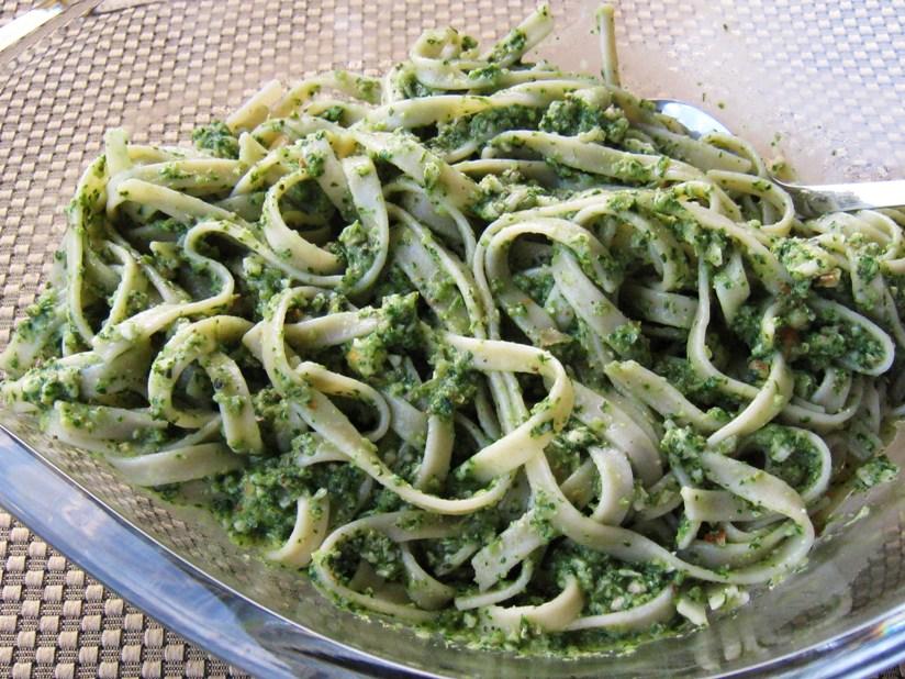oil-free spinach arugula pesto over fettuccine pasta