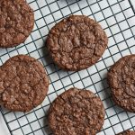 vegan dark chocolate molasses cookies on cooling rack