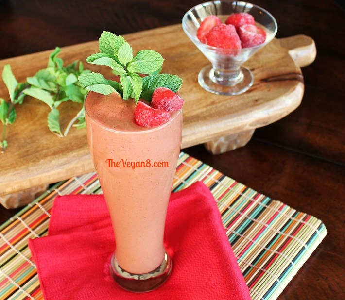 Mint chocolate strawberry shake in a tall glass