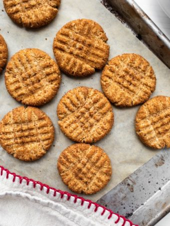 several peanut butter cookies on cookie sheet