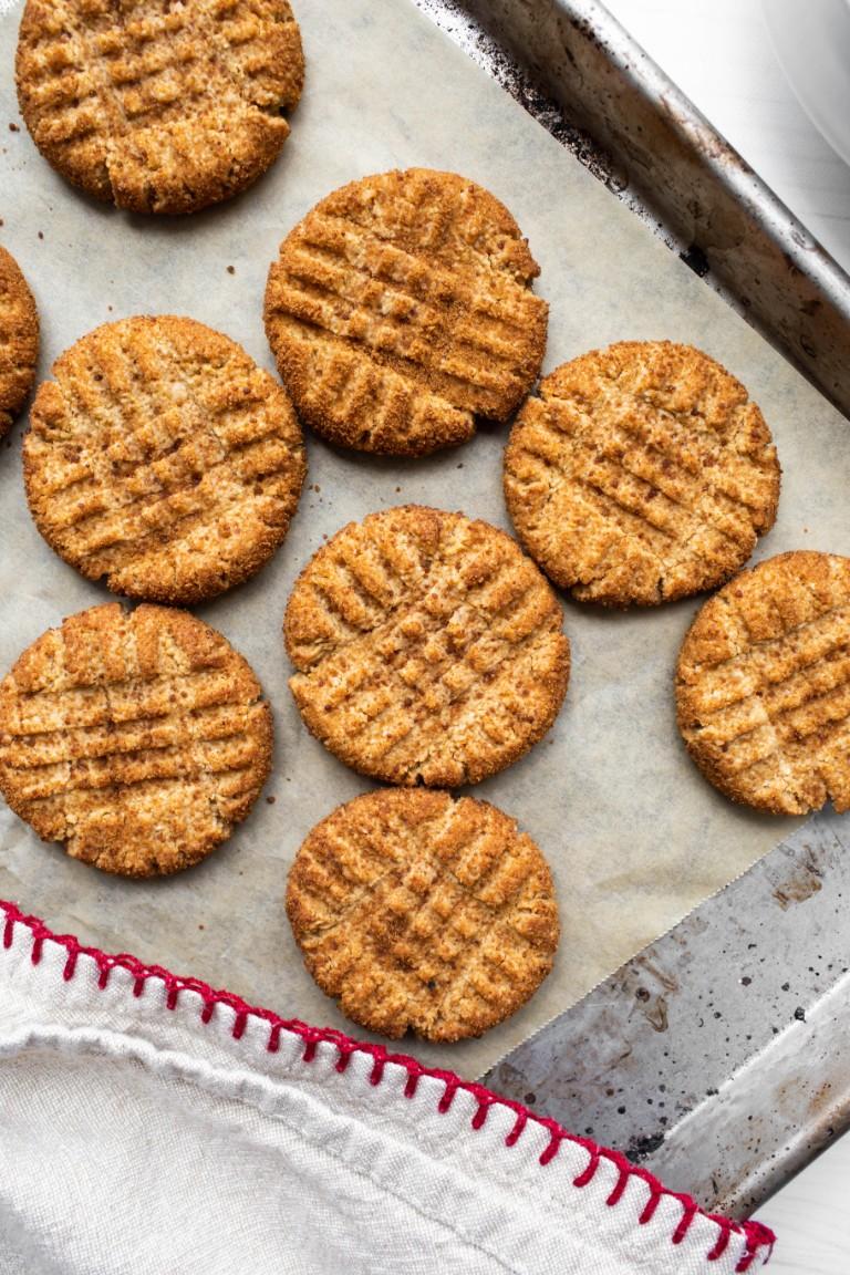 several vegan peanut butter cookies on pan closeup