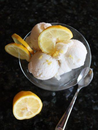 glass bowl of ice cream with fresh lemon slices