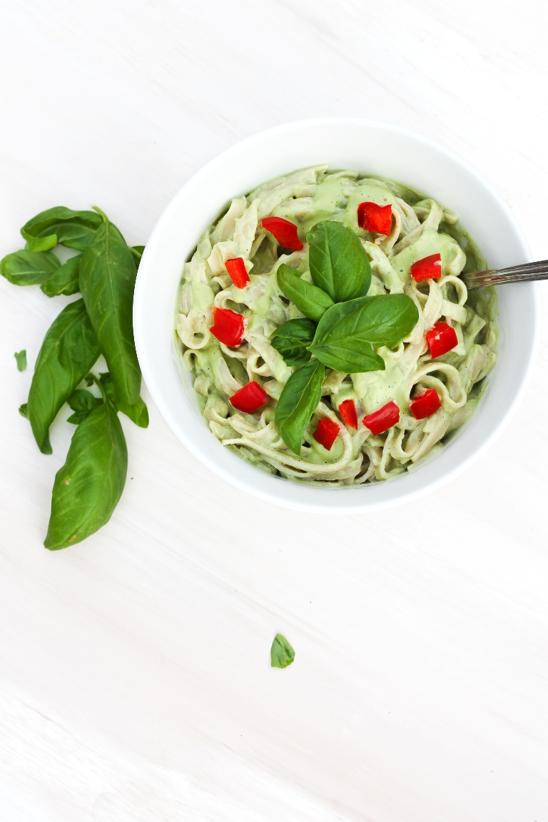 vegan basil cream sauce over pasta with tomatoes