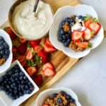 bowls of granola with fresh fruit and yogurt
