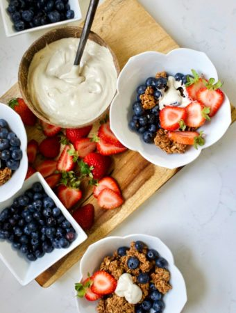 bowls of granola with fresh fruit and yogurt