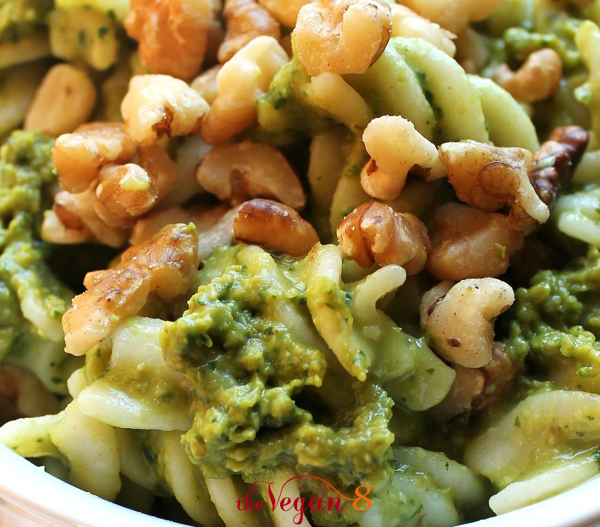 vegan kale pesto pasta with walnuts in white bowl
