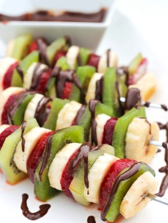 fruit on skewers with chocolate drizzle on top