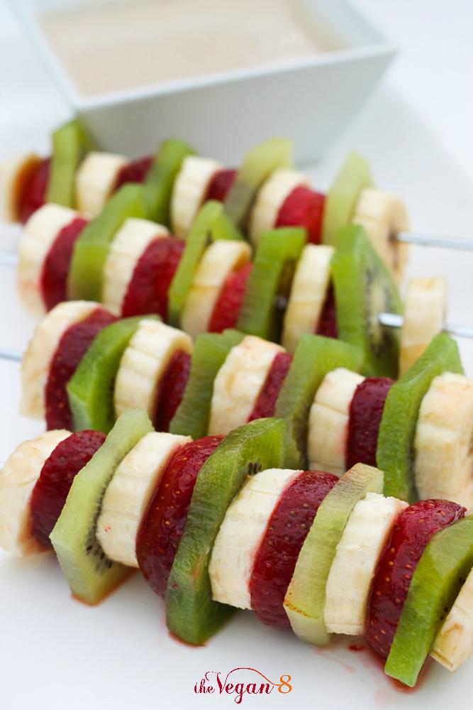 fruit kabobs on white platter