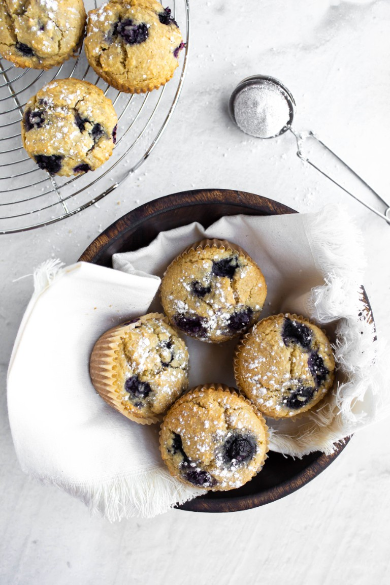 overhead shot of blueberry muffins in basket