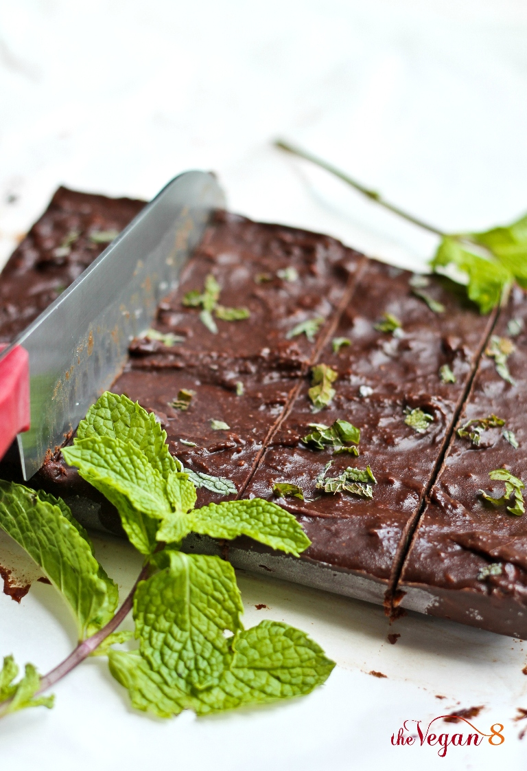 knife slicing through vegan mint chocolate fudge on parchment paper