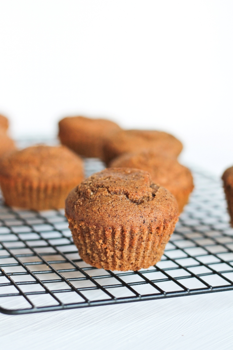 several baked pumpkin spice muffins on cooling rack