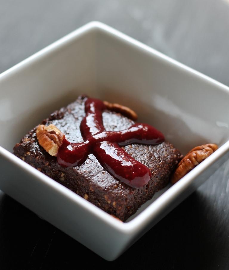 raw vegan no bake brownie in white bowl