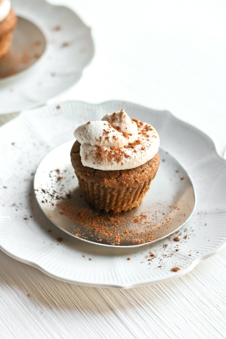 pumpkin muffin with coconut whipped cream on silver plate