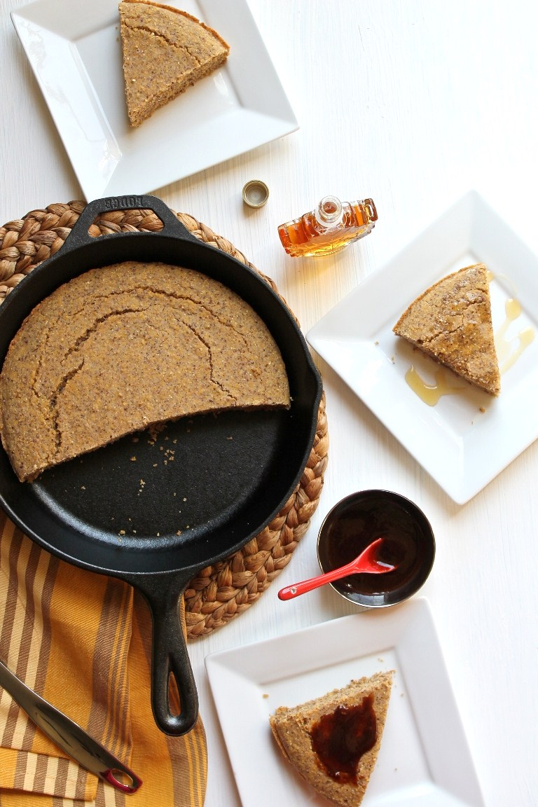 overhead image of skillet cornbread and plates with slices on them