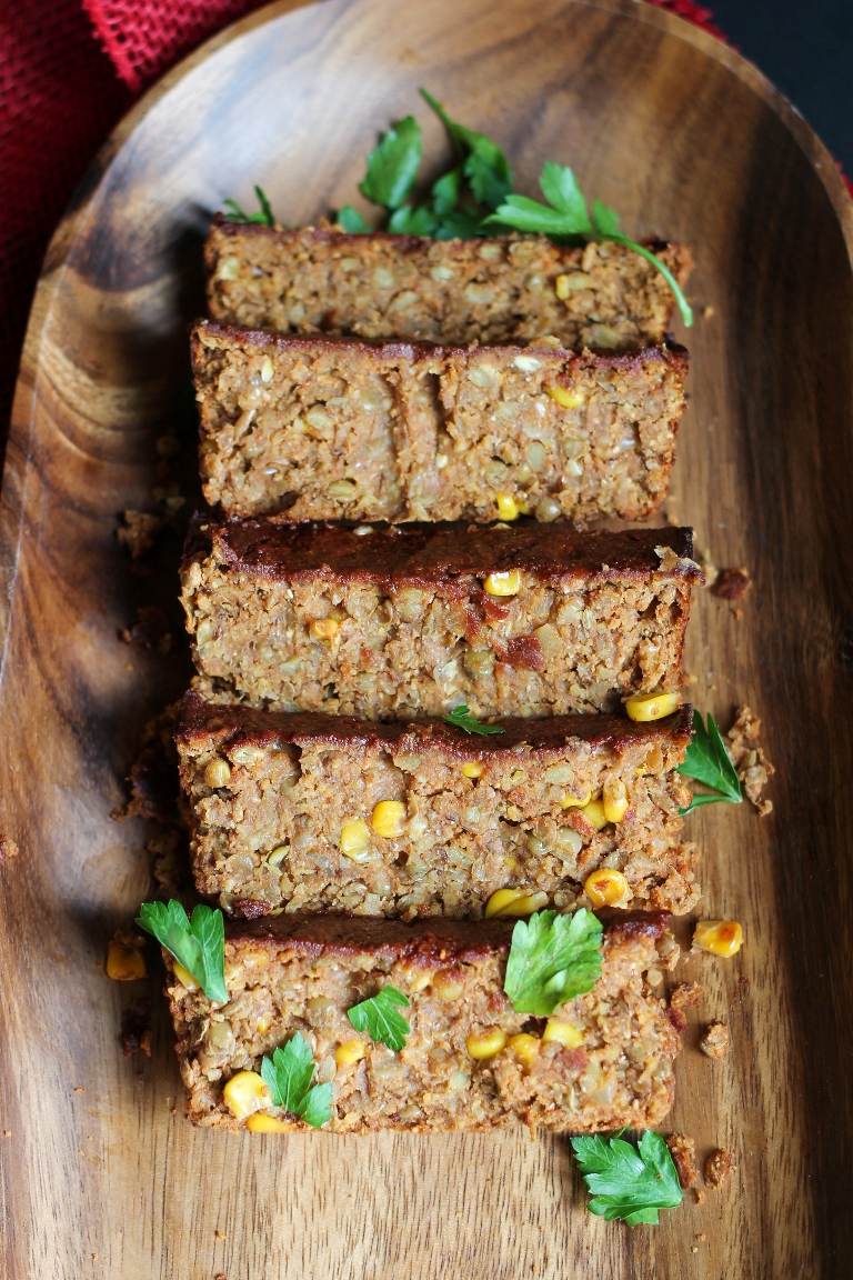 Sliced vegan barbecue lentil loaf on wood platter