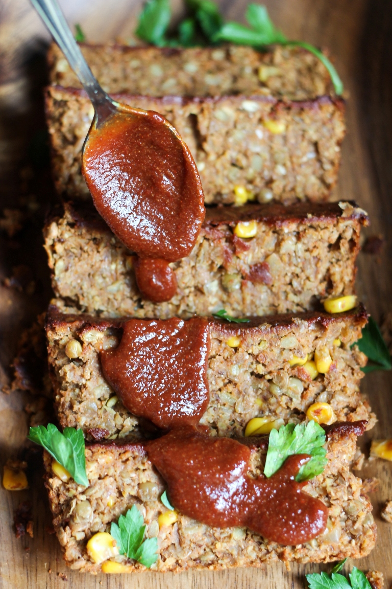 Slices of vegan barbecue lentil loaf with bbq sauce on top