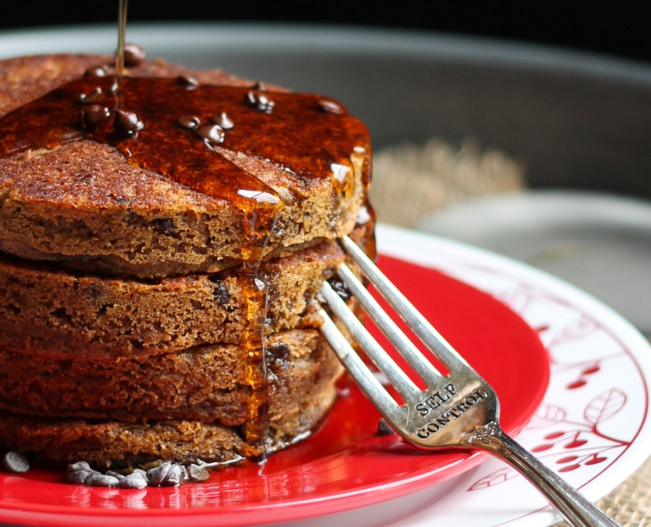 stack of vegan gluten free pumpkin pancakes on red plate with fork