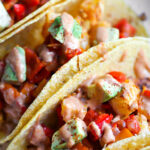 closeup of vegan Mexican potato tacos on platter