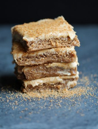 stack of vegan protein vanilla pecan bars on slate