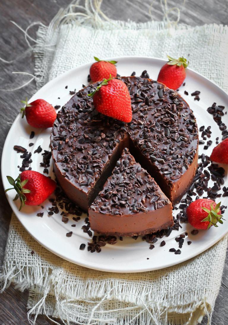 vegan chocolate cookie dough fudge cake with strawberries