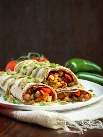 Easy Vegan Breakfast Burritos with Salsa on white plate