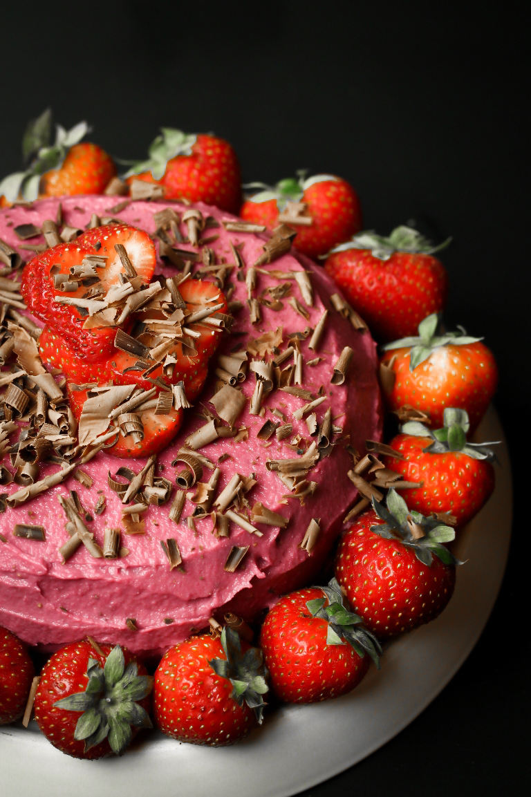 Beautiful chocolate cake decorated with strawberry frosting