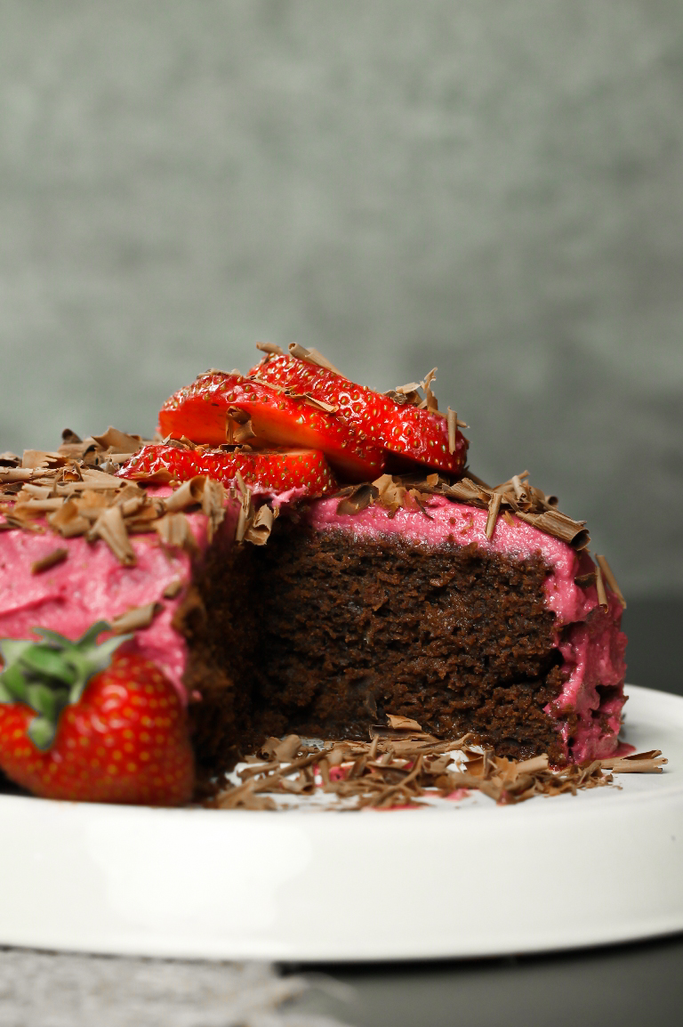 Inside view of chocolate cake with strawberry frosting