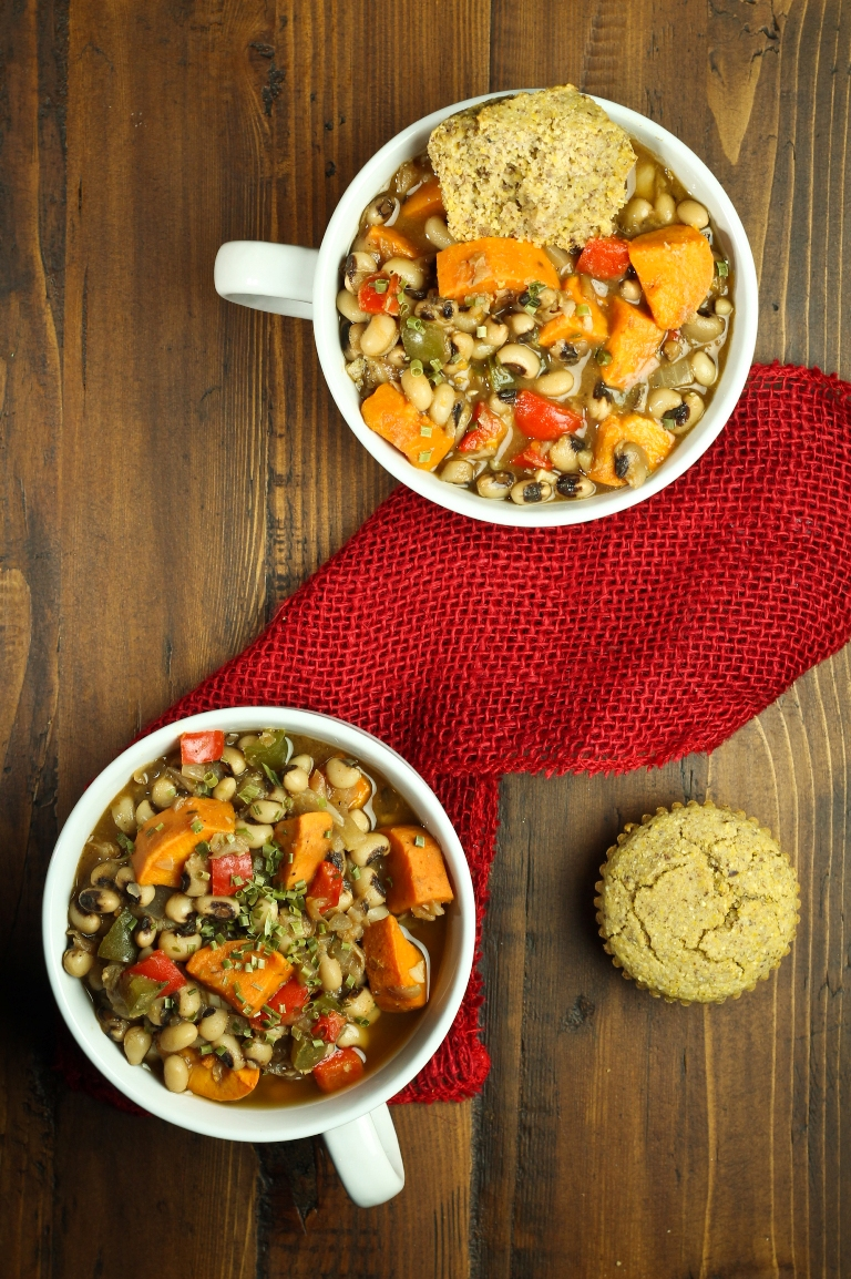 Overhead view of 2 bowls of sweet potato black-eyed pea soup