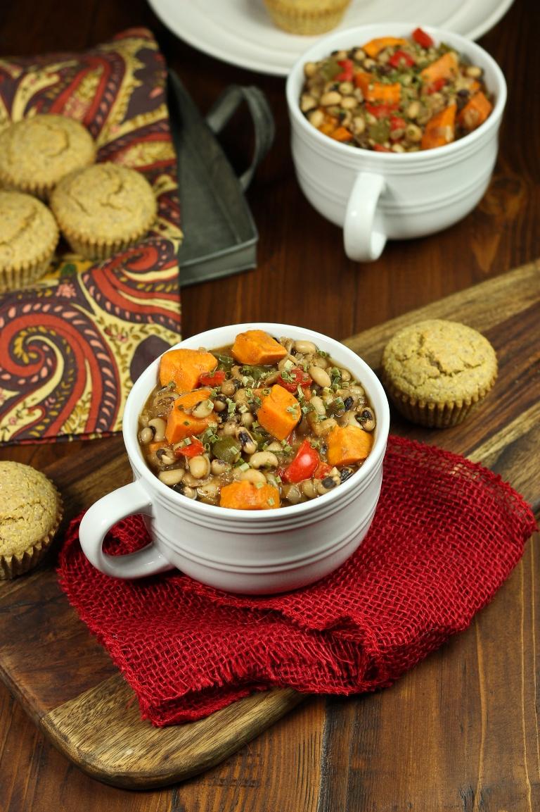 bowl of smoky sweet potato black-eyed pea soup on red napkin