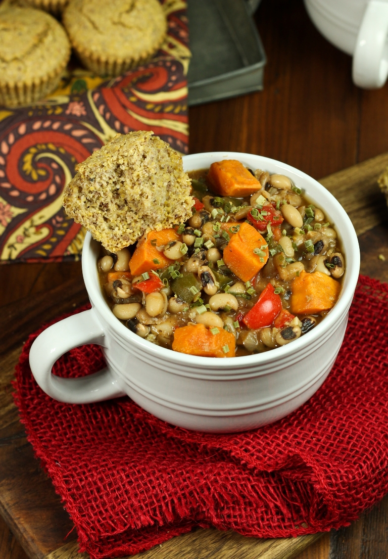 bowl of sweet potato and black-eyed pea soup with cornbread
