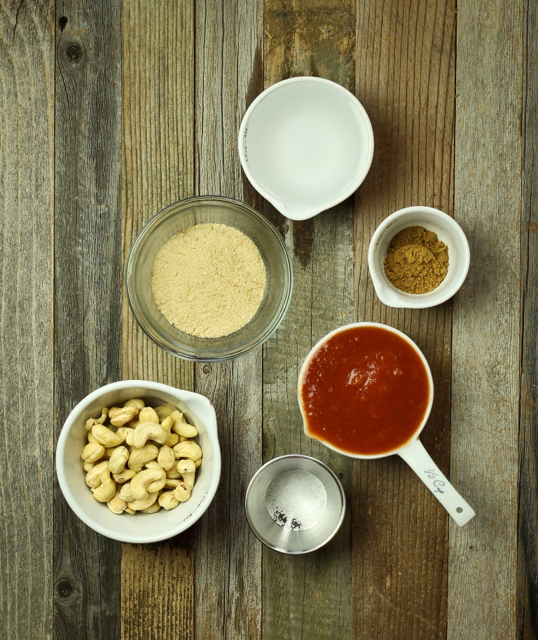 Vegan Mexican cheese sauce ingredients on wood table