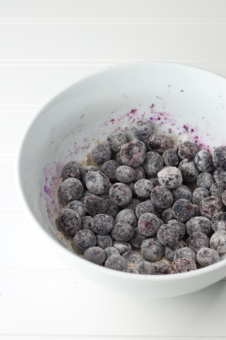 Bowl of blueberries coated with flour