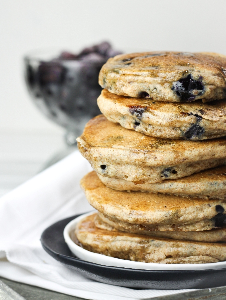 Closeup view of fluffy vegan blueberry pancakes stacked