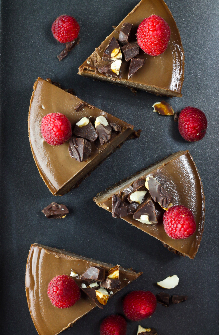Several cut slices of vegan chocolate cheesecake