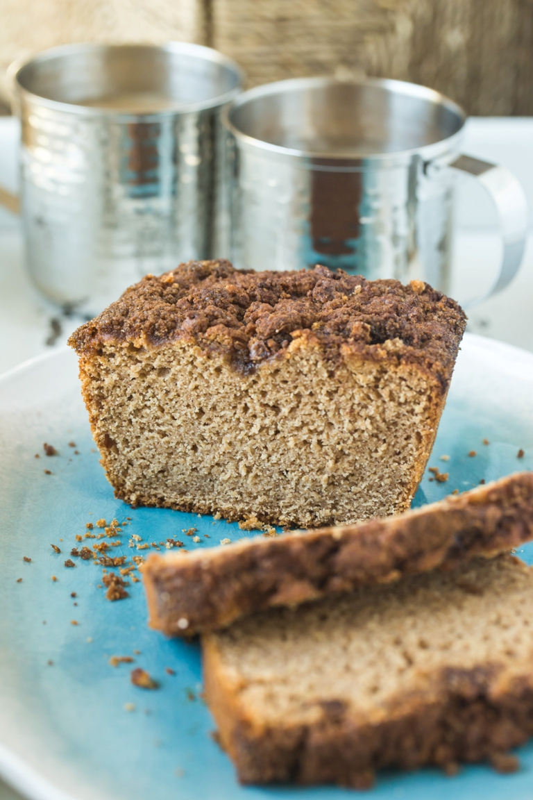 Sliced loaf of vegan cinnamon applesauce quick bread