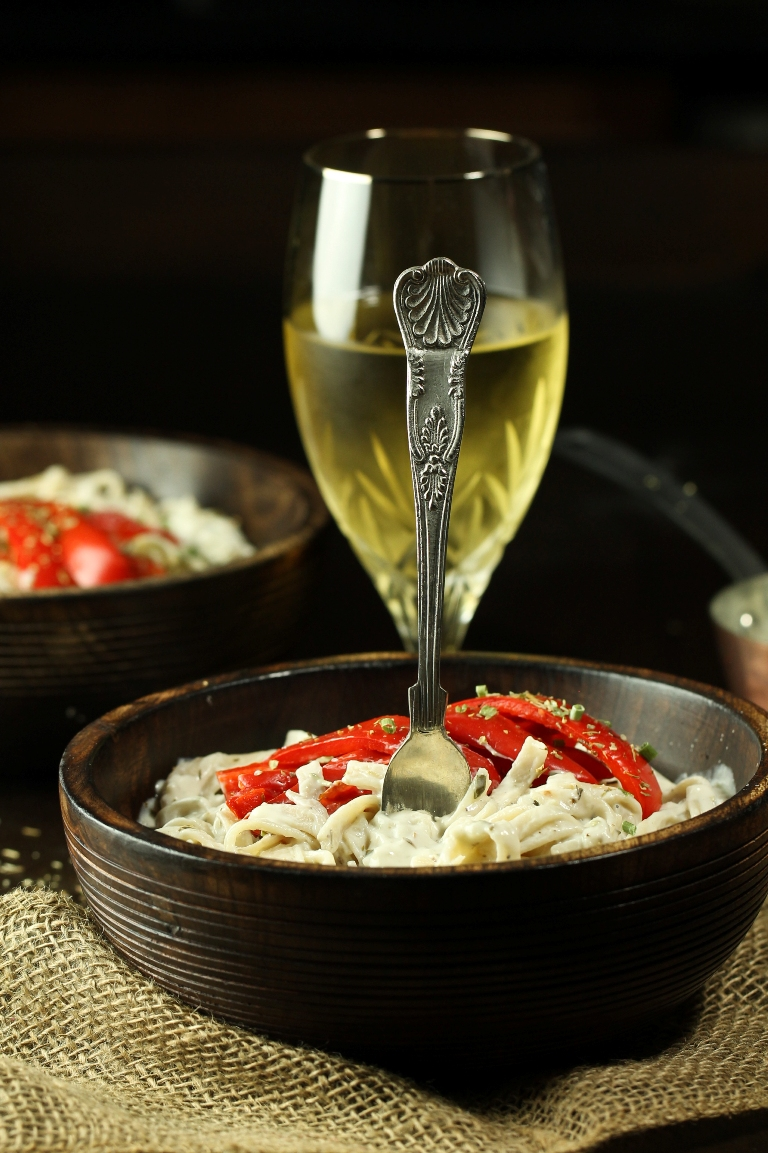 Wooden bowl of vegan creamy white wine sauce