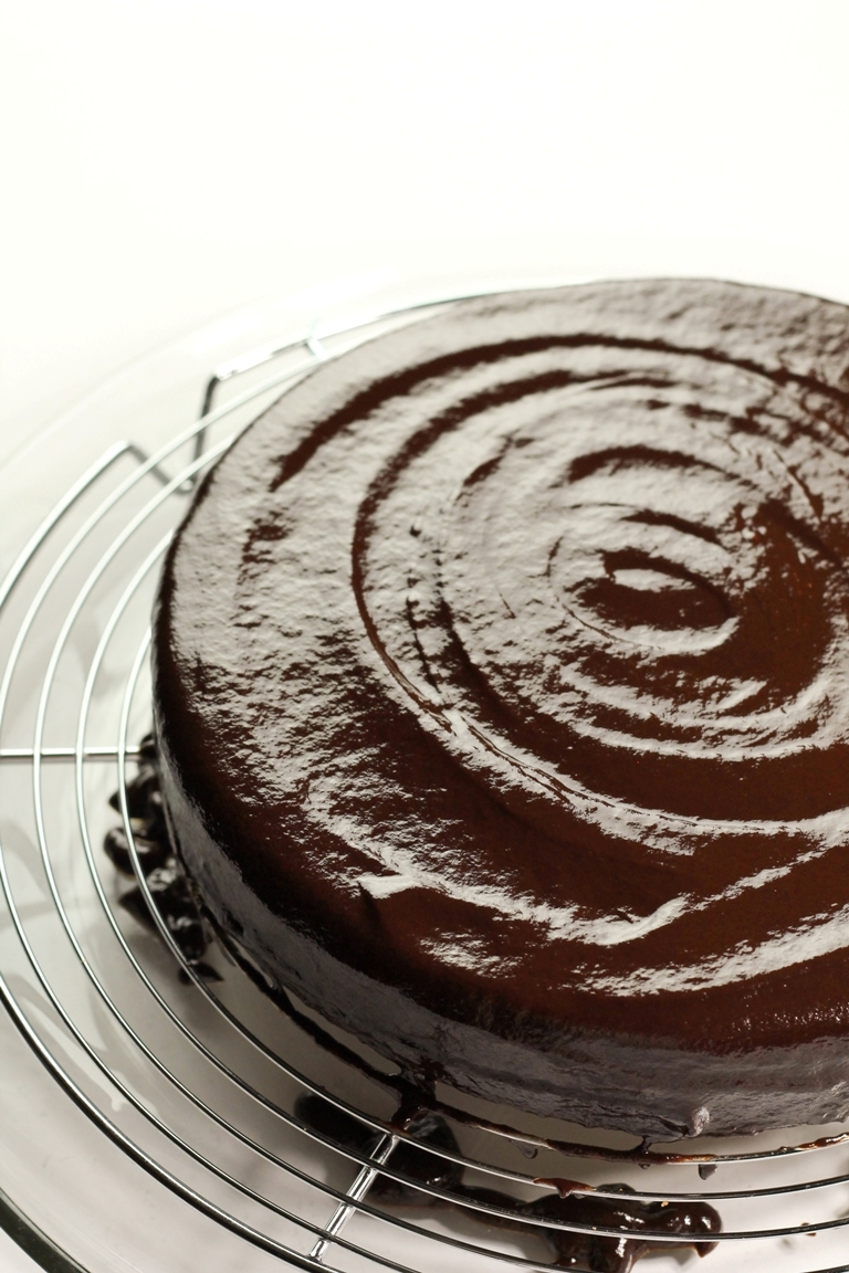Swirled wet chocolate ganache on top of cake