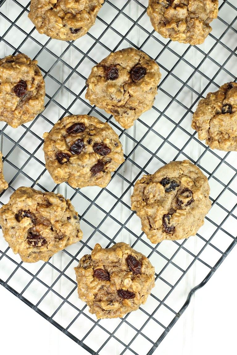 Baked vegan oatmeal raisin cookies on cookie rack
