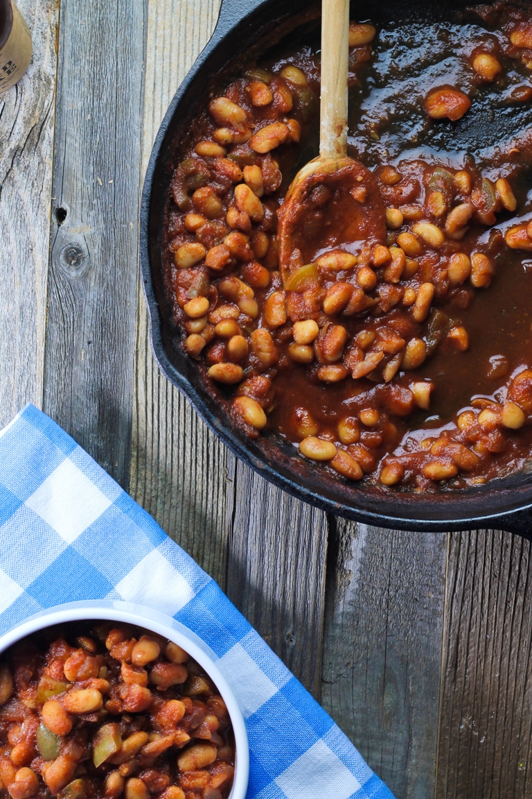 Vegan Skillet Barbecue Baked Beans with wooden spoon