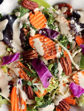 Closeup image of salad with vegan creamy Italian dressing.