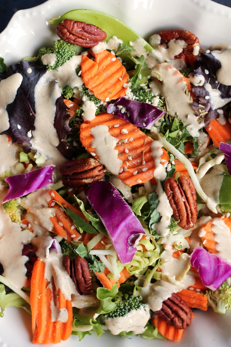 Closeup image of salad with vegan creamy Italian dressing.