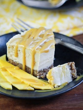 slice of vegan mango caramel cheesecake on plate