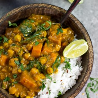 Vegan Sweet Potato Chickpea and Spinach Coconut Curry in wooden bowl