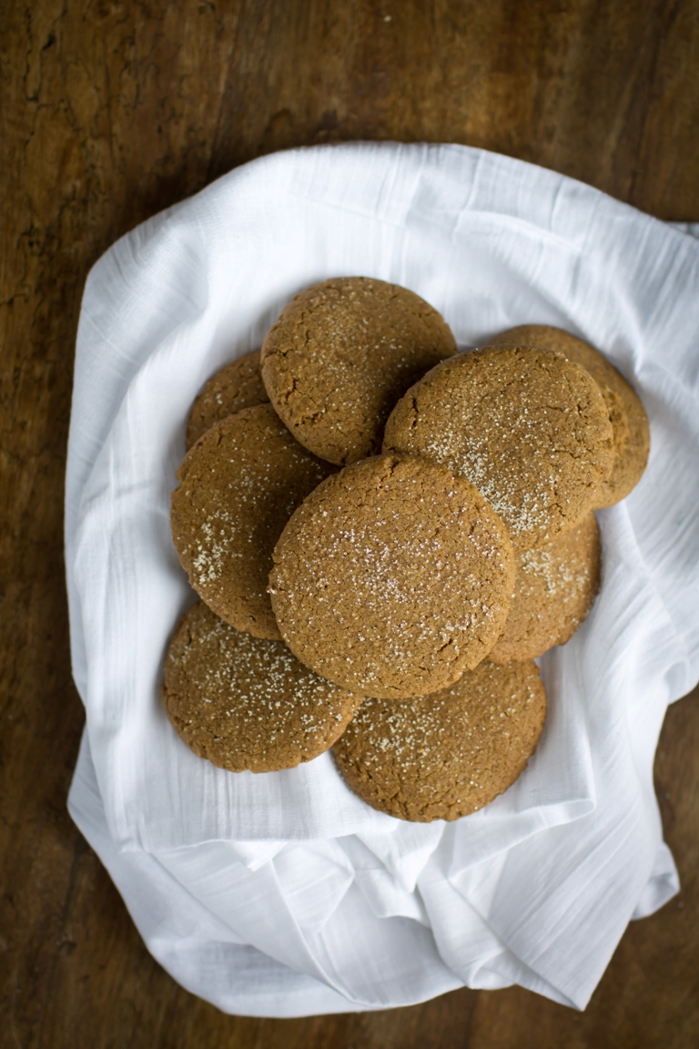 basked with white cloth with vegan gingersnaps