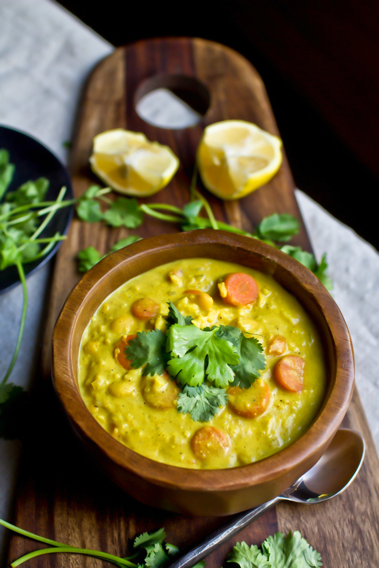 vegan curry rice soup on wooden board