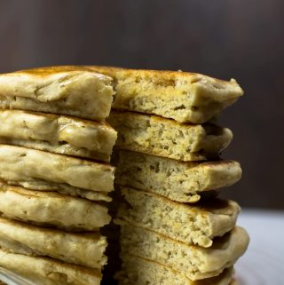 closeup of tall stack of vegan fluffy pancakes showing inside