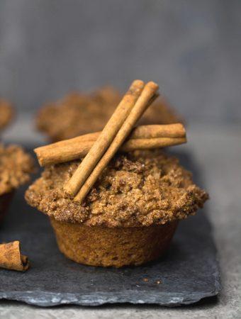 Vegan Bakery Style Cinnamon Streusel Muffins on slate