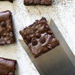 closeup overheat shot of zucchini brownies on white board with spatula