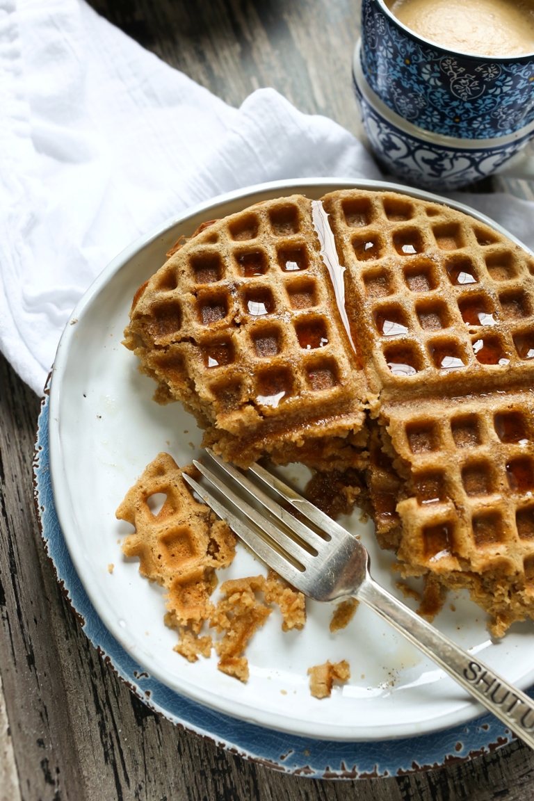 Half eaten plate of vegan chai waffles with fork