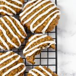 low fat vegan iced oatmeal cookies on cooling rack